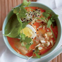 Fragrant laksa with toasted cashews and fresh herbs