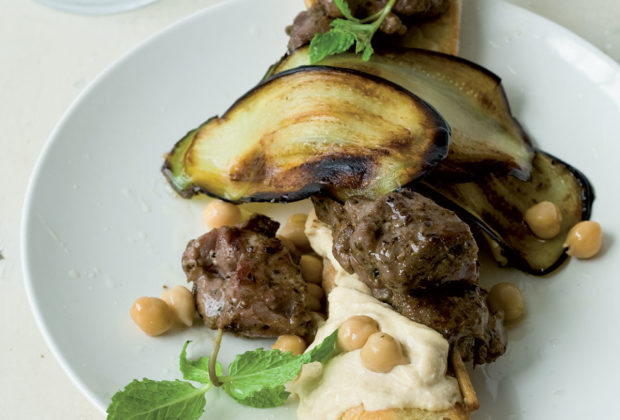 Greek lamb kebab, chargrilled brinjal and hummus on crusty bread sticks recipe