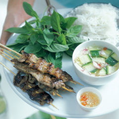 Grilled lemon grass beef skewers with lettuce, herbs and dips