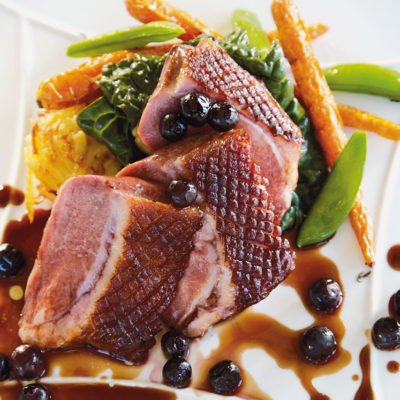 Zachary's smoked organic duck breast with sweet potato rosti and blueberry verjuice sauce