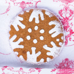 Oversized gingerbread biscuits with snowflake dusting