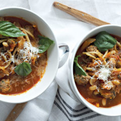 Herbed tomato-vegetable soup with spaghetti and meatballs