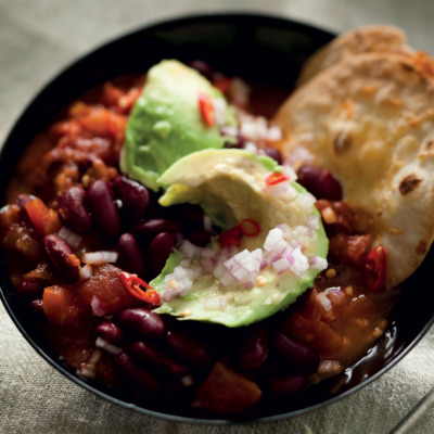 Spicy Mexican red kidney bean soup with chunky guacamole