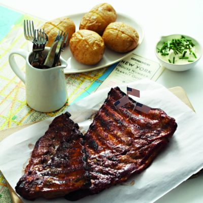 American barbeque ribs with baked potatoes and sour cream