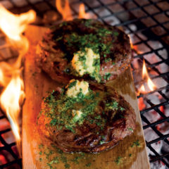Rump steaks on oak braai planks with mustard butter
