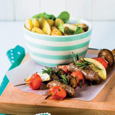 Lamb and veg kebabs with warm potato and watercress salad