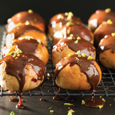 Cranberry and orange hot cross buns with milk chocolate drizzle