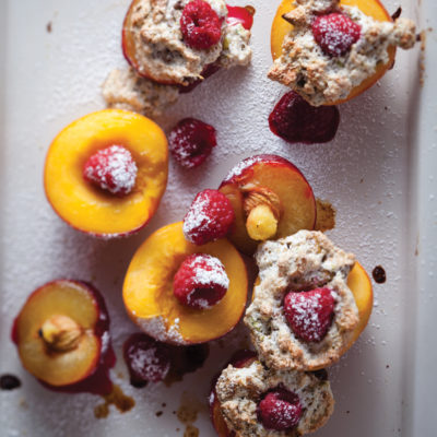 Roast peaches and plums with oats and pistachio meringue