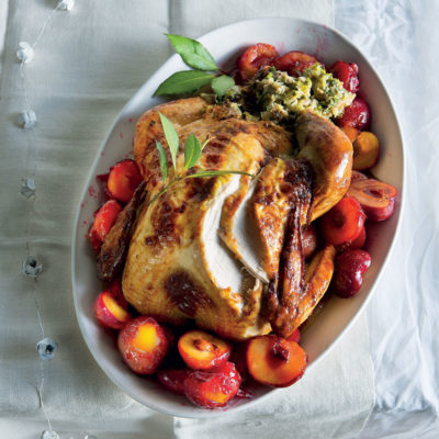 Buttery roast turkey with mushroom-and-sausage stuffing and roast plums
