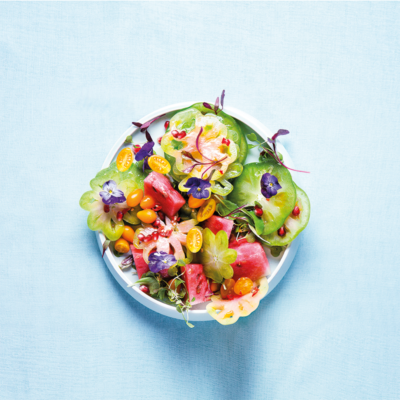 Tart green tomato and sweet watermelon salad with tomato seed dressing