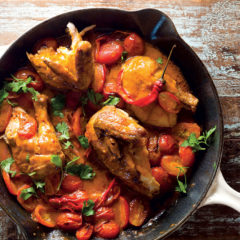 Rotisserie chicken and roast tomatoes in peri-peri sauce