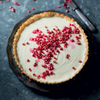 Pomegranate studded no-bake cheesecake with a coconut crust