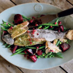 Pomegranate salt-roasted trout with balsamic beetroot and greens recipe