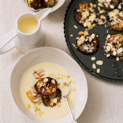 Spiced apple slices with almonds and stuffed dates