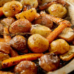 Ultimate slow-cooked potatoes and carrots for your Easter roast