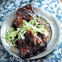 Asian treacle-sugar ribs with spring onion curls