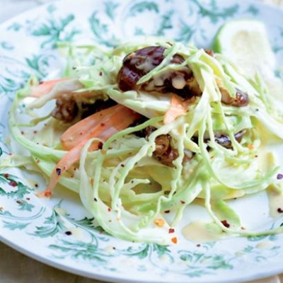 Baby cabbage slaw with dates tossed in a garlic-and-malt mayo