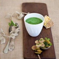 Baby spinach soup topped with chunky green olives and oregano