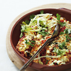 Baked beef and bean burritos with spicy tomato sauce, mozzarella and feta