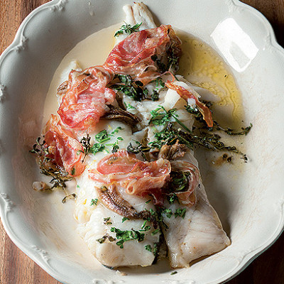 Baked hake with crisp pancetta and anchovies