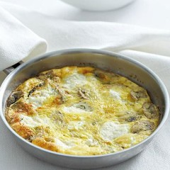 Baked mushroom and cheese omelette with sorrel salad