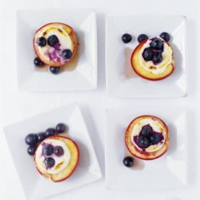 Baked organic nectarines with cream cheese, maple syrup and blueberries