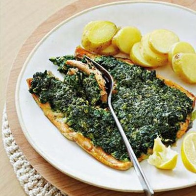 Baked organic spinach crusted trout