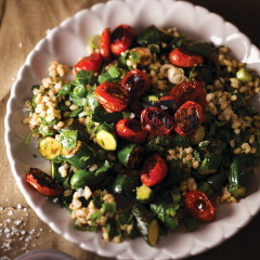 Barley salad with sauteed baby rosa tomatoes and baby marrows