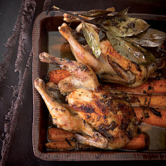 Bay and anchovy roast baby chickens with buttery carrots