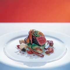 Beef fillet with roasted vegetables and glazed spring onions on crushed herb potatoes