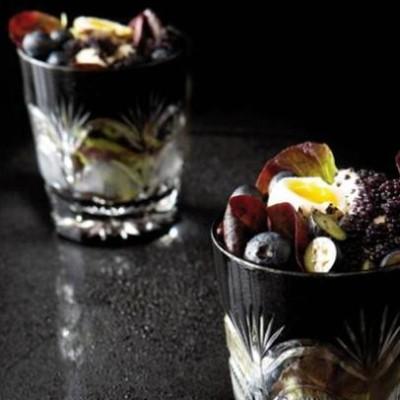 Blueberry salad with quail eggs and caviar