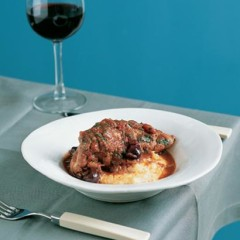 Braised chicken, tomato and olives on soft polenta