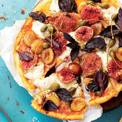Buffalo mozzarella, fig and prune pizza with purple basil and caper berries