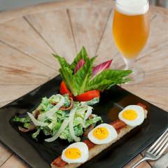 Caesar salad with quail eggs