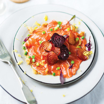 Candied beetroot with salmon carpaccio, baby peas and black pepper sour cream dressing