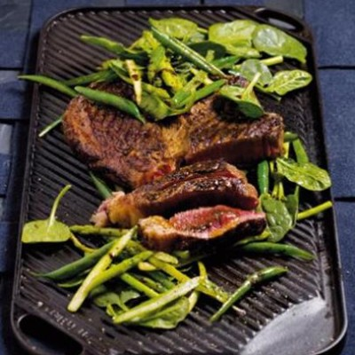 Chargrilled sirloin steaks with crisp greens tossed in a spicy dressing