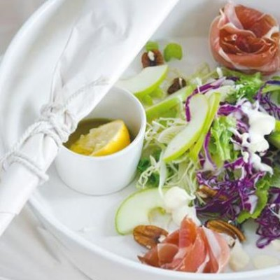 Chilli and lemon dressed crunchy salad with serrano ham roses