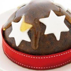 Classic Christmas pudding drenched in thick honey and ginger syrup