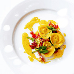 Confit of rabbit and green olive in saffron tortellini