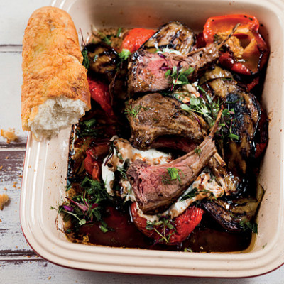 Coriander and mustard-crusted rack of lamb with pomegranate grilled brinjals and roast red peppers