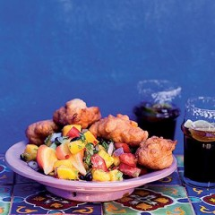 Corn fritters with mango-and-black bean salsa served with Mexicola