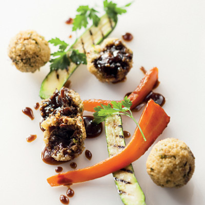 Couscous and lamb rib croquettes with roast carrots and baby marrow ribbons