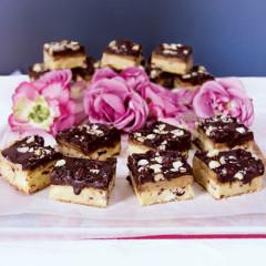 Cranberry and macadamia chocolate millionares shortbread
