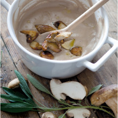 Creamed porcini soup topped with panfried mushroom