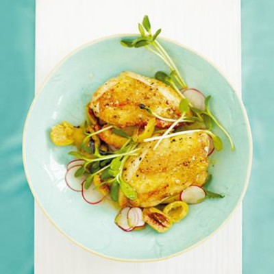 Crisp chicken breasts with oak-smoked salt, pan-fried garlic, sunflower sprouts and baby radish