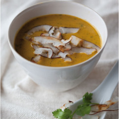 Curried butternut soup with crisp coconut shavings