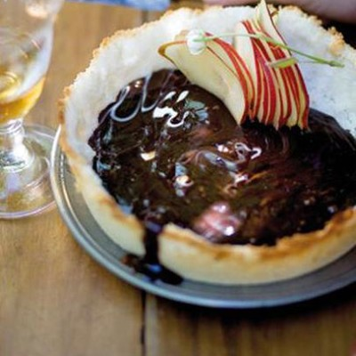Dark chocolate and coconut tart with pear shavings