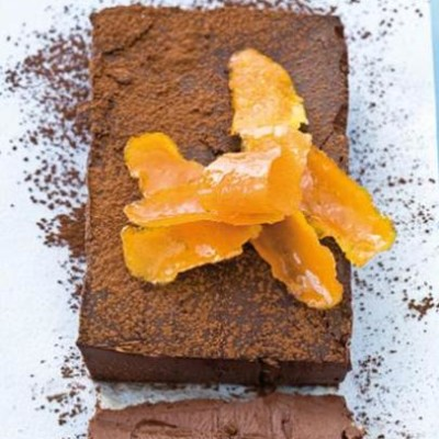 Dense chocolate and orange slab cake with candied orange