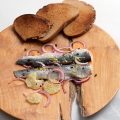 Dressed herring fillets on rye