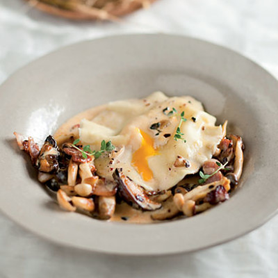 Duck egg ravioli with exotic mushroom sauce